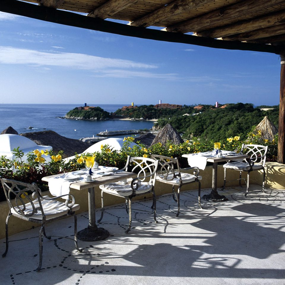 Boutique Dining Drink Eat Ocean Rustic Scenic views Waterfront sky umbrella Beach Resort restaurant Villa shore Deck