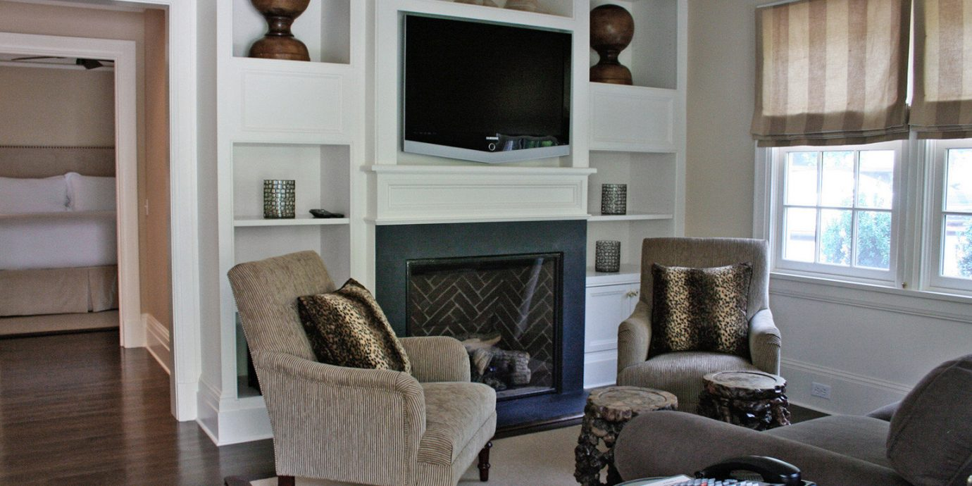 Beach Boutique Fireplace Inn Romance Romantic living room property home hardwood cottage condominium flooring