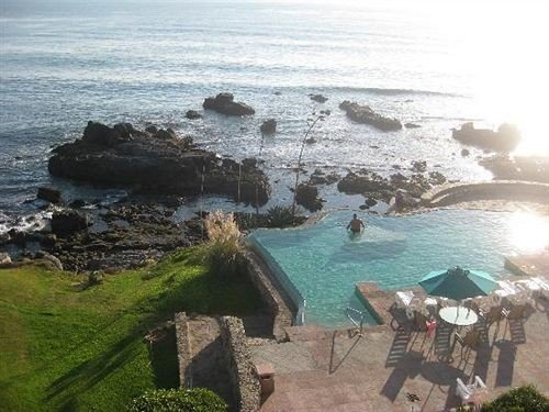 Budget Classic Ocean Pool Waterfront water Nature Coast shore Sea Beach rock cliff cove cape terrain overlooking promontory