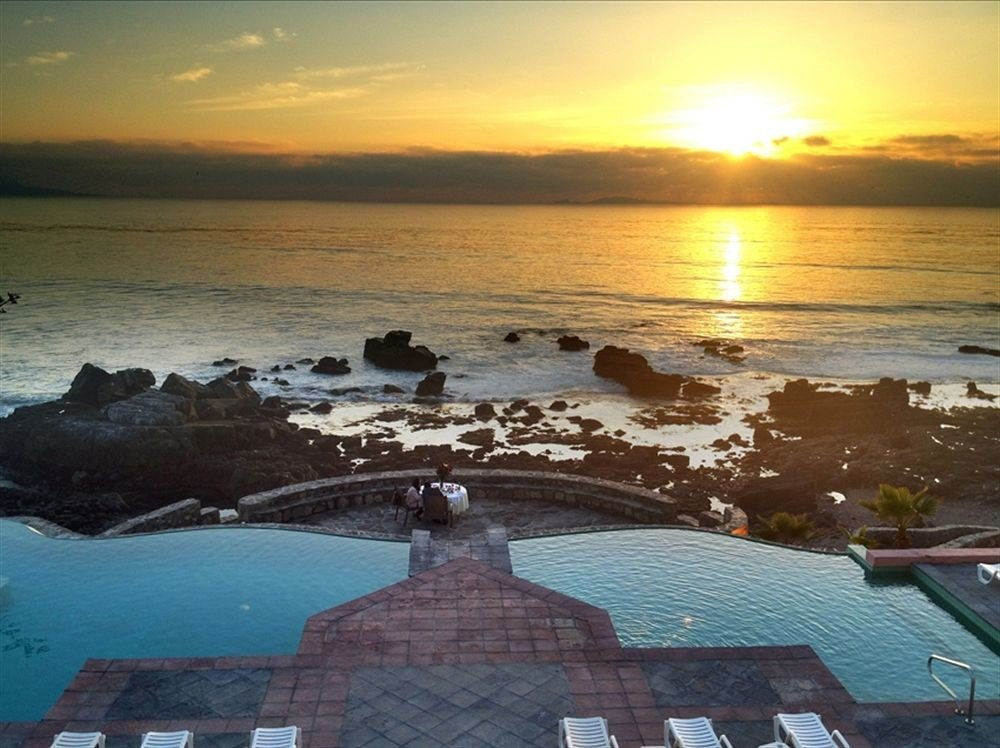 Budget Classic Ocean Pool Sunset Waterfront water sky Sea shore Beach horizon Coast cloud morning sunrise evening dusk dawn sunlight wave cape