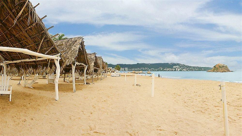 Beach Budget Family Resort Tropical sky ground chair Sea shore sand Coast Ocean walkway sandy day
