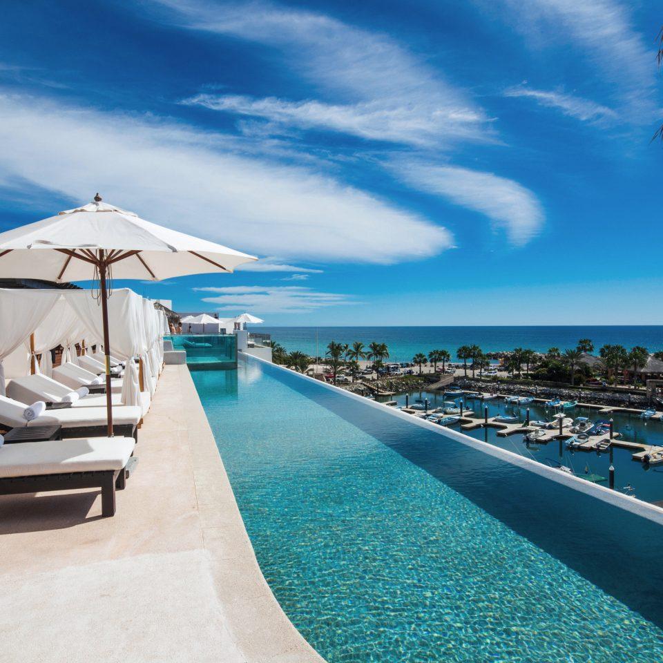 Budget Hotels Luxury Pool Scenic views Waterfront sky Sea chair Beach Ocean caribbean swimming pool Resort marina Coast dock Lagoon blue lined shore sandy