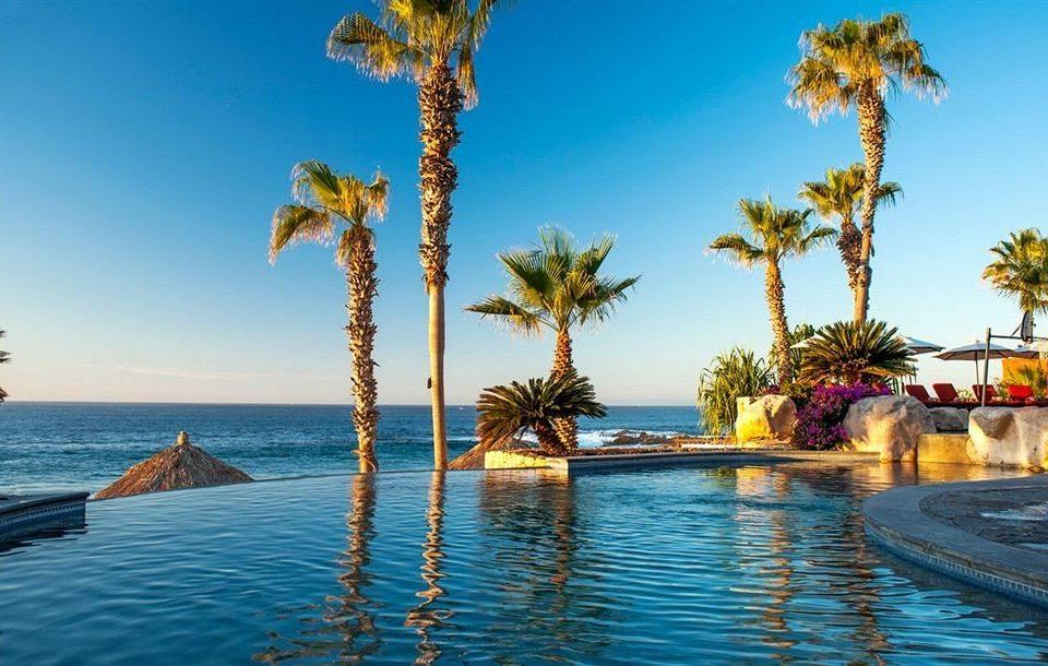 Budget Pool Resort Scenic views Tropical Waterfront sky water tree umbrella palm Beach Sea Ocean swimming pool caribbean arecales Coast tropics palm family cape Lagoon lined plant swimming sandy