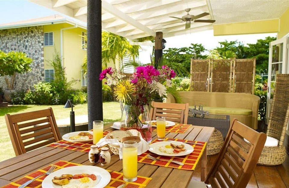 Beach Budget Dining Eat Sea property chair home porch cottage outdoor structure Resort backyard restaurant living room condominium Villa Courtyard dining table