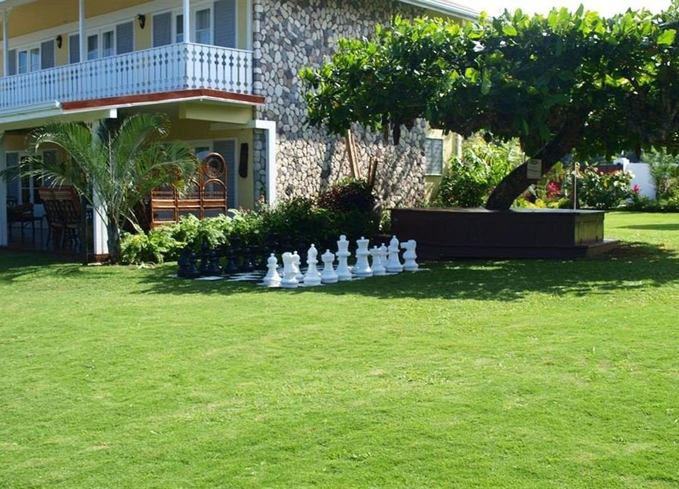 Beach Budget Garden Grounds Sea grass tree property building lawn yard backyard green home landscape architect Villa walkway house landscaping outdoor structure shrub Courtyard cottage grassy plant lush