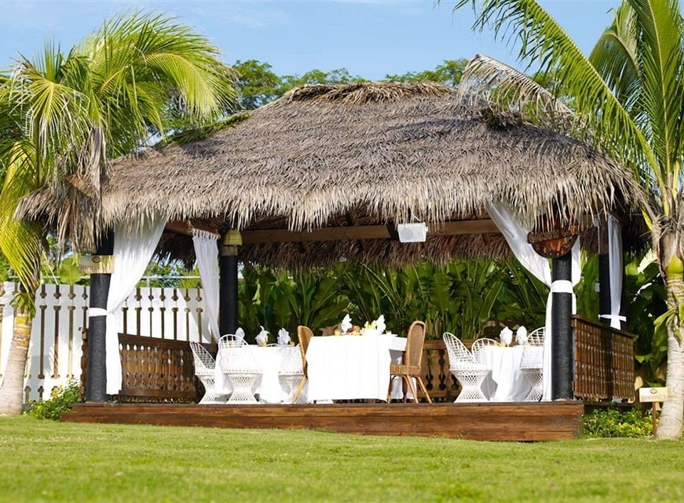 Beach Budget Dining Grounds Sea grass sky property Resort hacienda arecales Villa hut tree palm