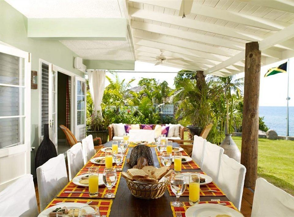 Beach Budget Dining Sea property home Resort restaurant cottage condominium Villa dining table