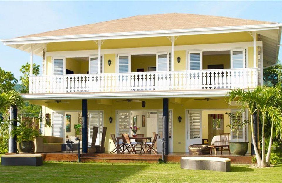 Beach Budget Grounds Sea grass building property house home Villa Resort mansion condominium cottage porch