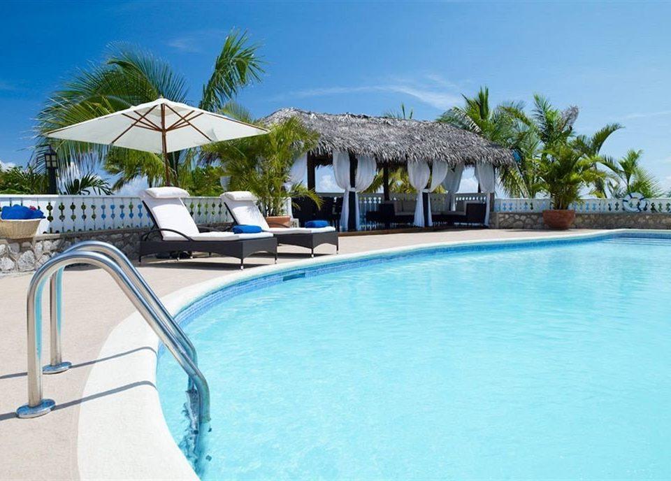 Beach Budget Pool Sea tree sky swimming pool property leisure Resort caribbean Villa resort town Lagoon blue mansion condominium eco hotel swimming
