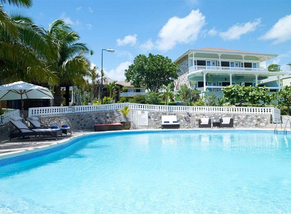 Beach Budget Pool Sea sky water Resort tree swimming pool property leisure condominium blue swimming resort town Villa reef day