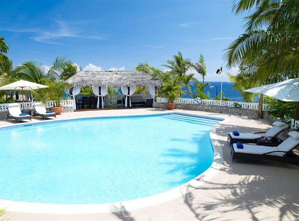 Beach Budget Pool Sea tree sky Resort swimming pool property leisure caribbean Villa resort town condominium reef blue swimming lined