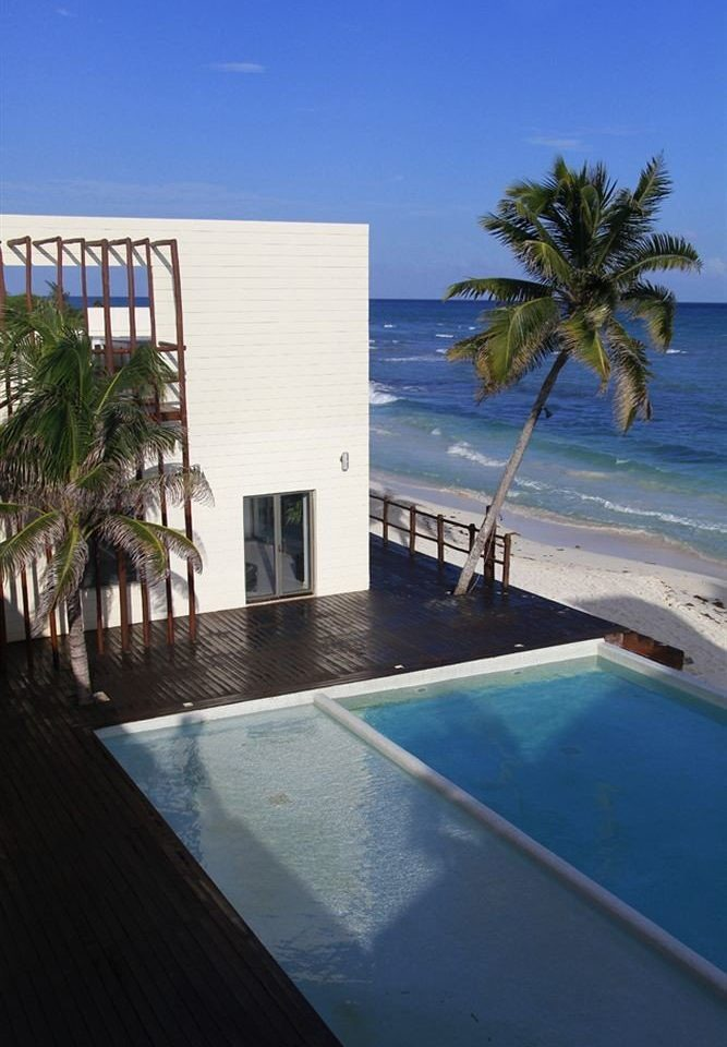 Buildings Exterior Hip Lounge Luxury Modern Pool swimming pool property building Ocean Sea Beach caribbean Resort condominium Coast Villa arecales palm dock shore Deck empty Island