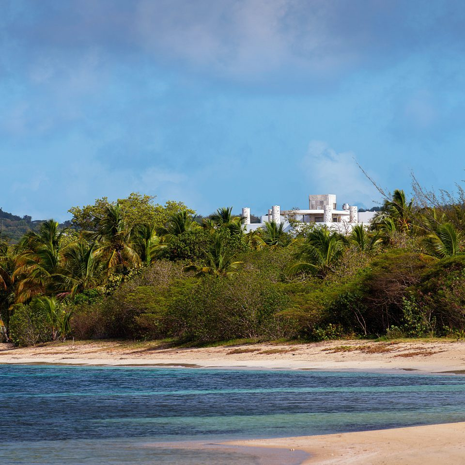 Buildings Exterior Grounds Hotels Scenic views tree sky water Beach shore Coast Sea Nature Ocean cloud landscape cove Lagoon sand Island cape day sandy