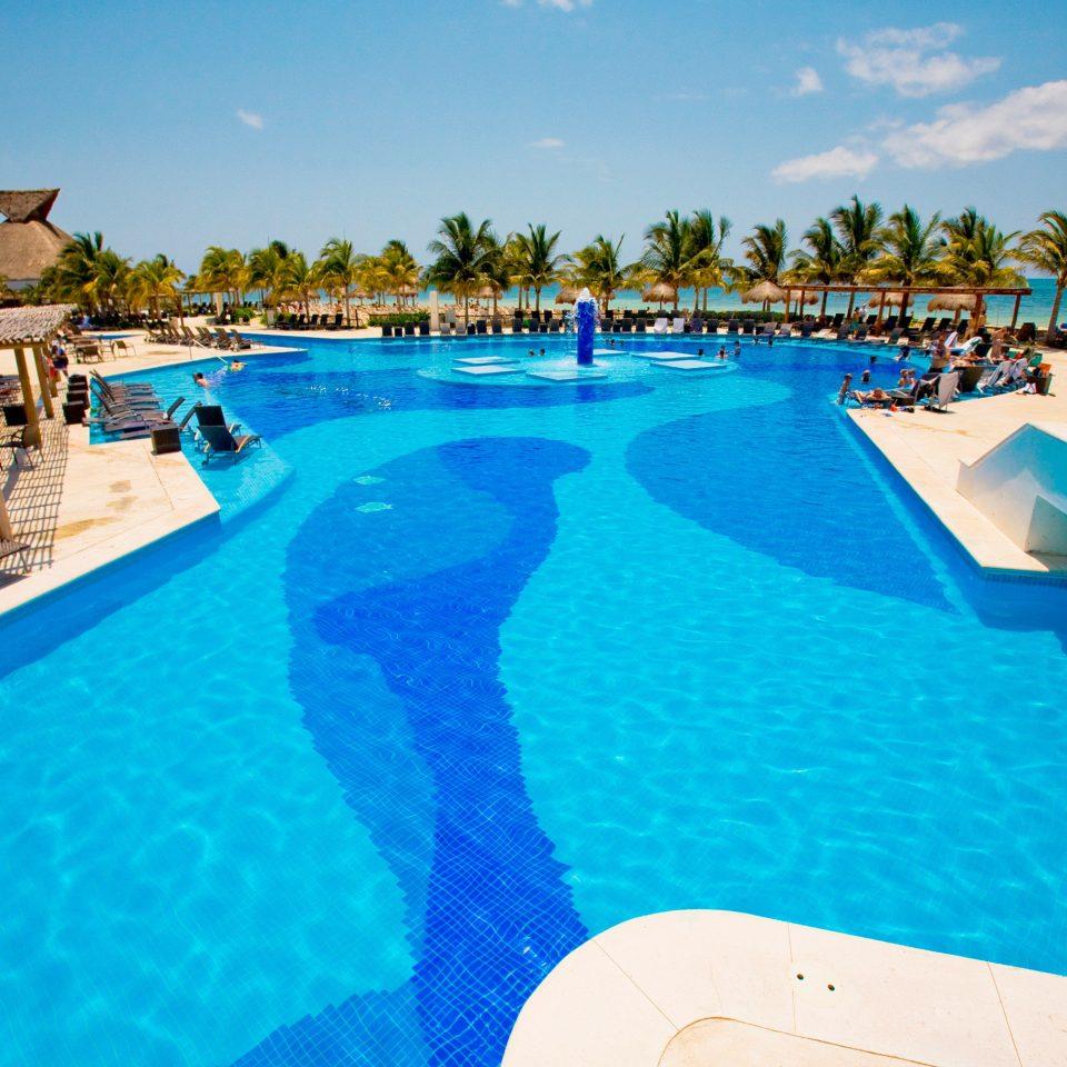 Buildings Exterior Lounge Luxury Modern Pool Tropical sky water swimming pool leisure Resort swimming Beach caribbean blue Water park resort town Lagoon Sea lawn reef