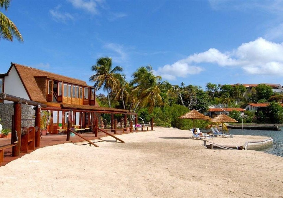 Beach Buildings Exterior Scenic views sky ground tree property Resort Villa swimming pool home hacienda shore sandy day
