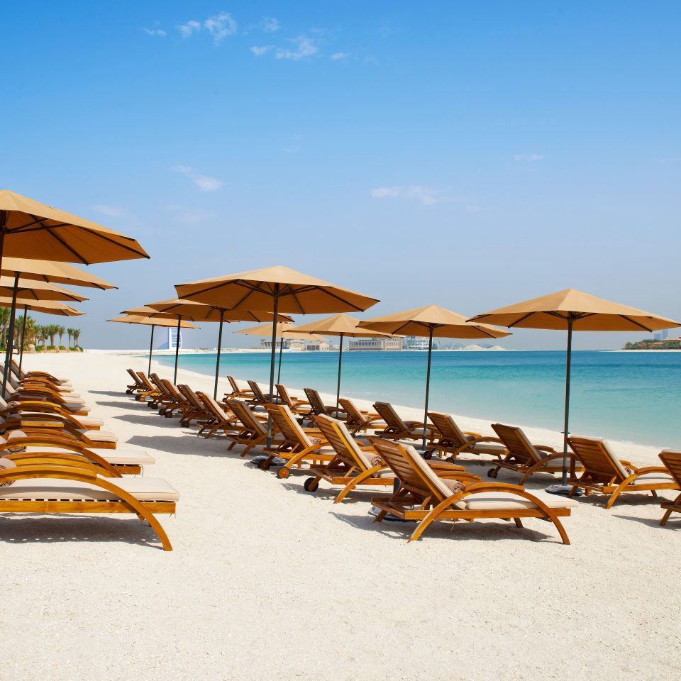 Beach City Family Modern Resort Spa Waterfront umbrella chair sky leisure lawn shore Sea Ocean Coast sand lined set day