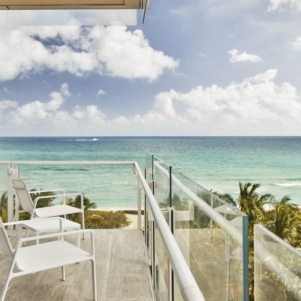 City Hotels Luxury Miami Miami Beach Sea property sky Ocean shore palm tree arecales condominium Beach horizon Resort caribbean Coast cloud