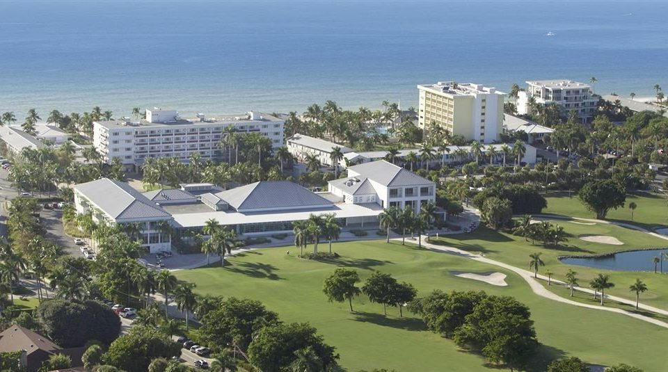 Beach Golf Grounds Ocean grass sky property residential area bird's eye view house structure Resort Town aerial photography sport venue suburb Nature marina mansion City hillside shore lush