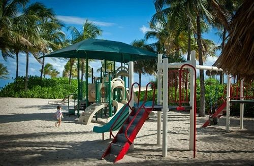 tree ground Beach leisure public space City Playground Resort outdoor play equipment Play lawn palm shade sandy
