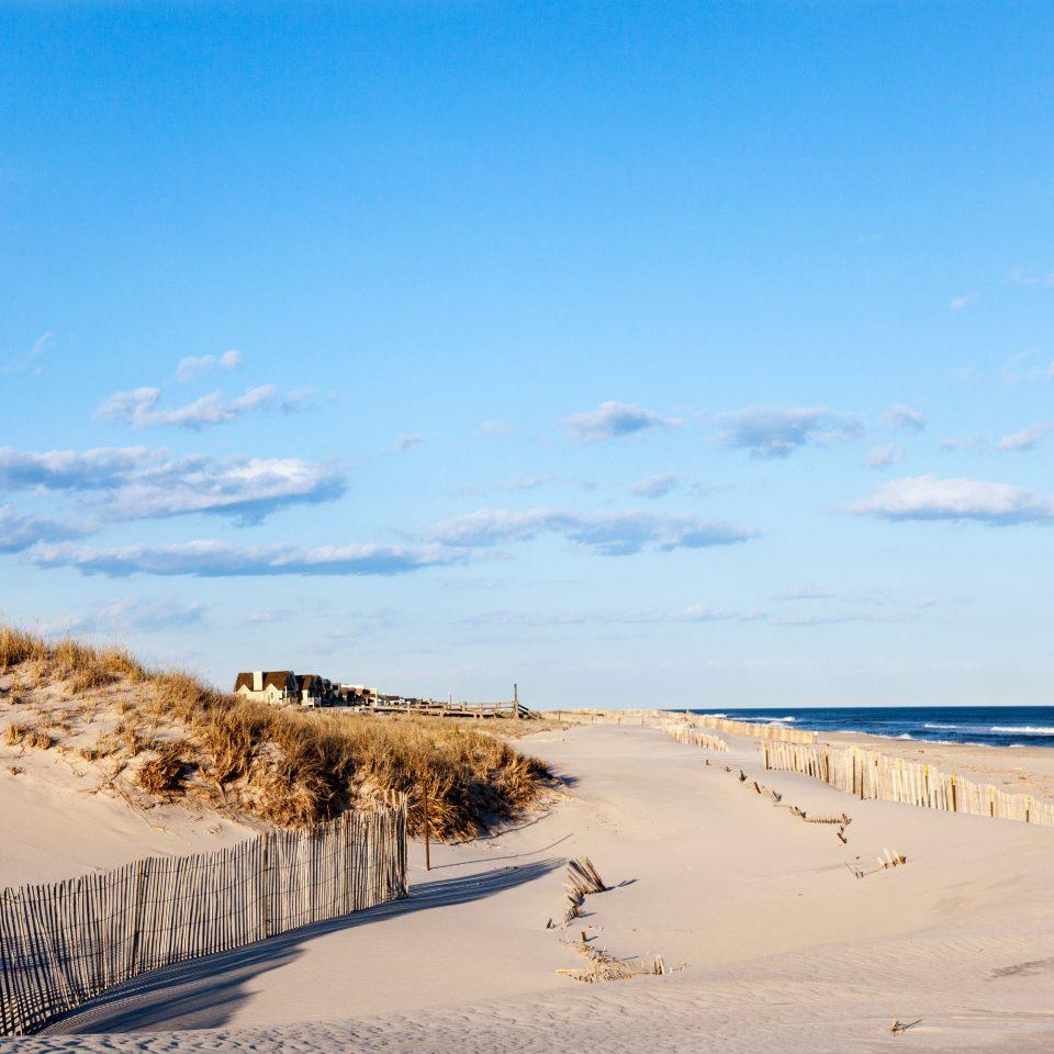 Beach Classic Inn Romantic Spa Waterfront sky habitat shore natural environment Nature sand horizon Sea dune Coast Ocean aeolian landform landscape material day