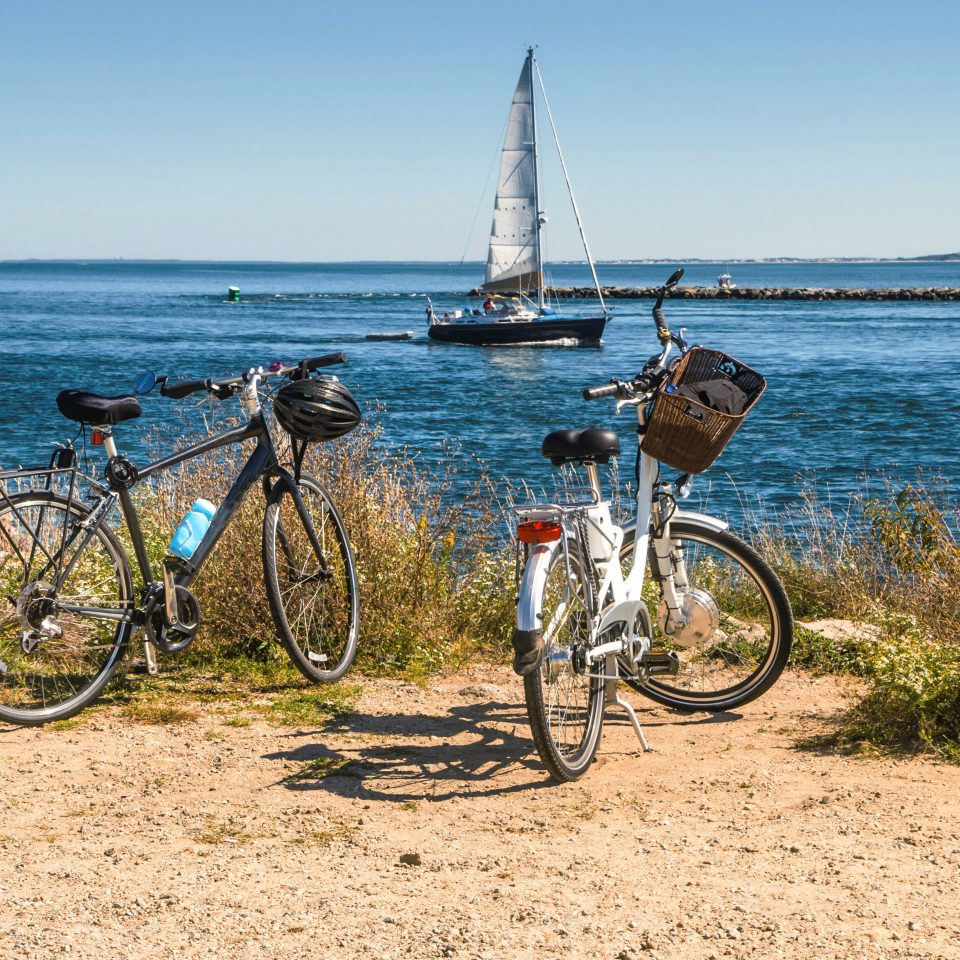 Beach Classic Inn Outdoor Activities Romantic Spa Waterfront sky water bicycle ground vehicle Ocean Sea parked Lake Coast mountain bike edge sports equipment sand shore overlooking