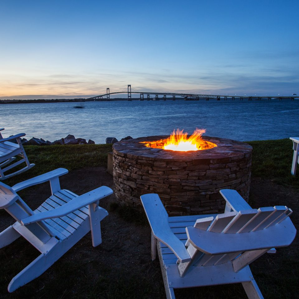 Firepit Outdoors Pool Scenic views Waterfront sky chair water blue Sea Beach Ocean shore set vehicle Coast dock lawn row Deck empty line