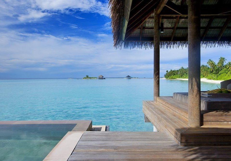 water sky Sea leisure Ocean caribbean Beach Resort shore swimming pool overlooking Coast Lagoon tropics Deck empty shade swimming Island