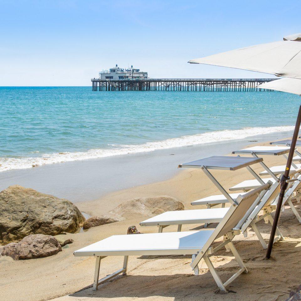 sky water chair Beach ground shore leisure Sea Coast Ocean caribbean Nature lawn cape sand cove Resort sandy Deck day Island