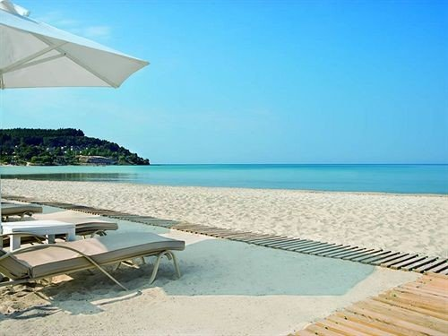 sky water Beach ground chair umbrella leisure property Sea shore caribbean swimming pool Ocean Nature lawn Coast Resort Lagoon Villa cape empty shade Deck day sandy