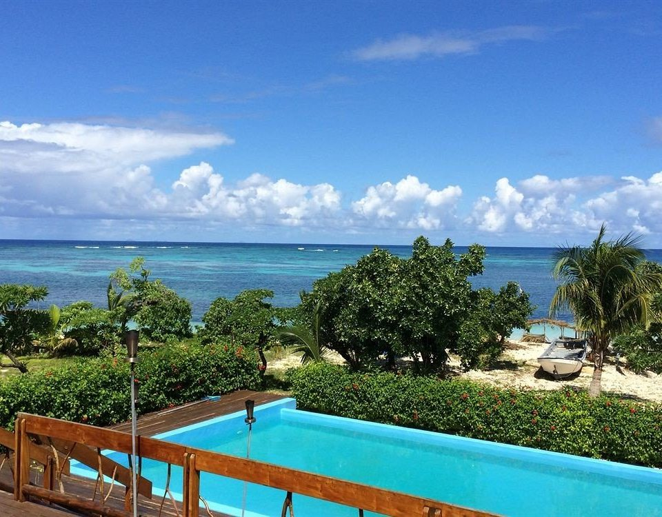 sky tree property swimming pool caribbean Resort leisure Ocean Sea Villa Beach Coast Lagoon Deck blue overlooking shore