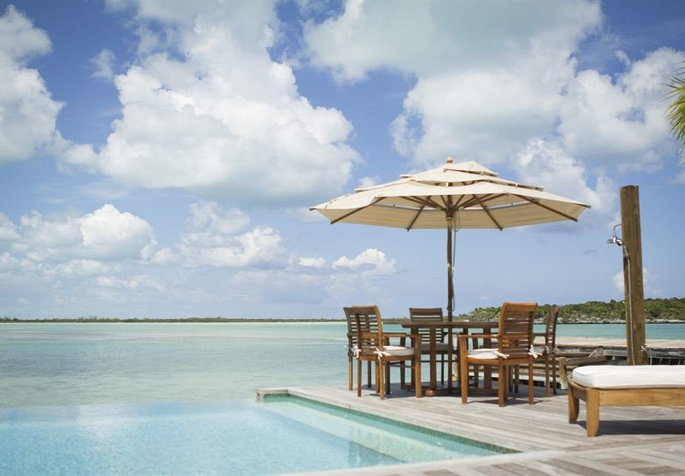 Deck Lounge Luxury Pool sky water Beach Sea Ocean caribbean Resort swimming pool Coast Lagoon shore day