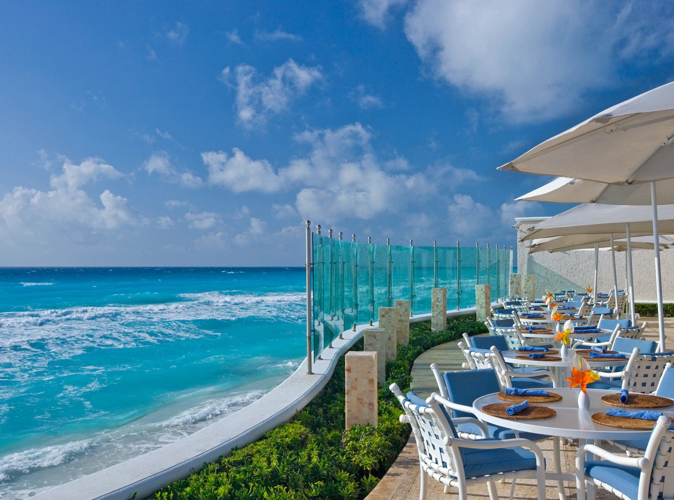 sky chair umbrella water lawn Ocean Sea Beach caribbean Nature shore horizon Coast Resort vehicle cape marina dock Deck swimming day sandy