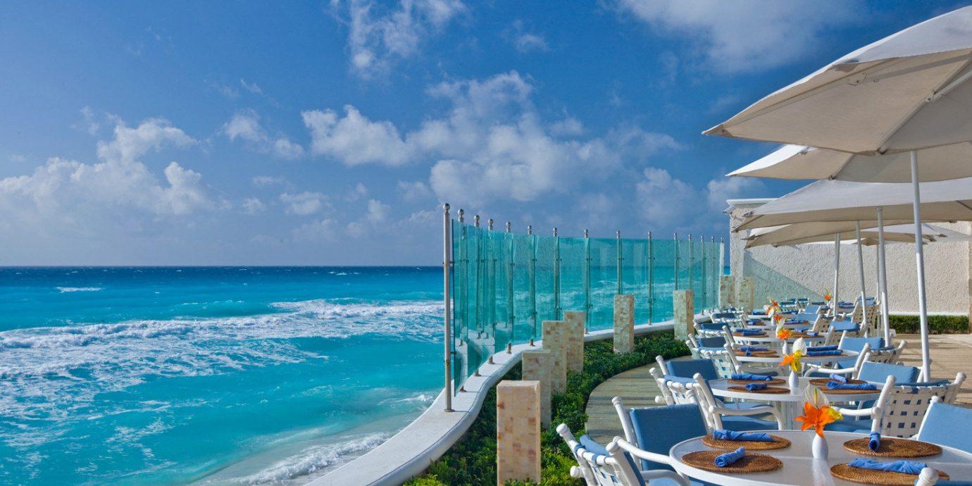 sky chair umbrella water lawn Ocean Sea Beach caribbean Nature shore horizon Coast Resort vehicle cape marina dock Deck swimming day sandy