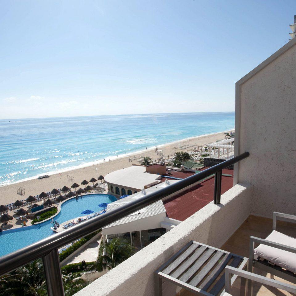 sky property Sea Ocean Nature Coast caribbean vehicle Beach Resort cape Villa shore Deck