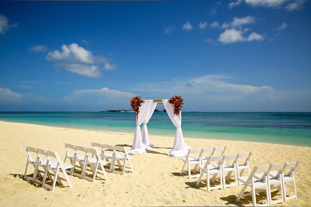 sky Beach water shore Nature chair Sea horizon Ocean white ceremony sand Coast caribbean sandy Deck day