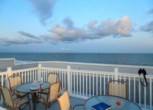 sky chair water property Sea passenger ship Ocean caribbean vehicle overlooking Deck Beach Coast ship Resort shore day dining table