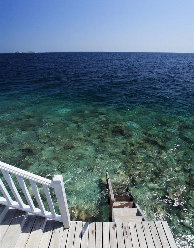 sky water ground Sea shore Ocean Coast wooden horizon Beach cape Deck terrain empty overlooking
