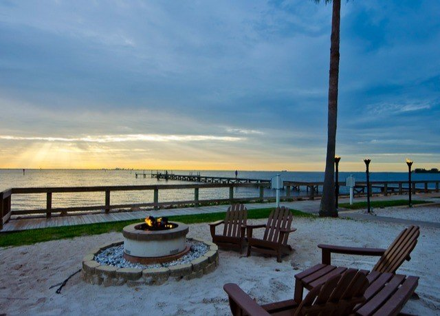 sky Beach Sea chair shore Ocean Coast Resort walkway dock overlooking Deck set day sandy dining table