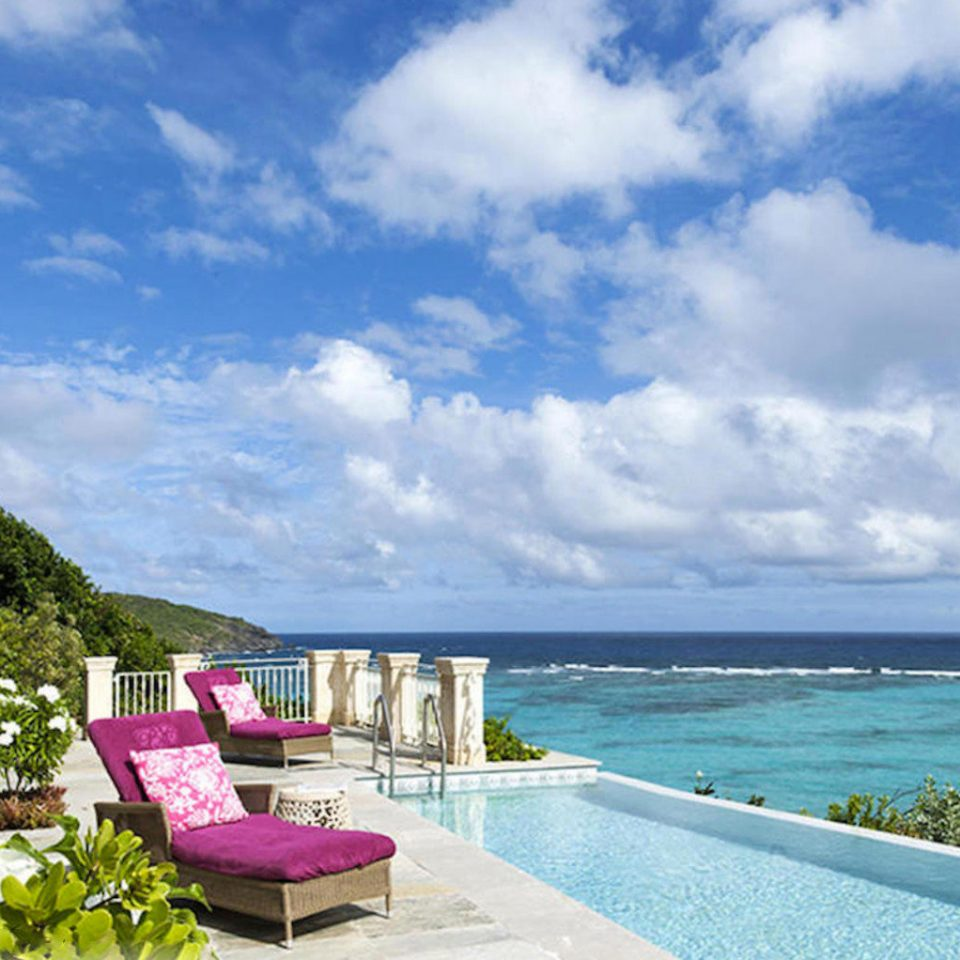sky water property caribbean Sea Resort Ocean Beach Coast Villa swimming pool overlooking shore Deck day