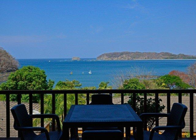 sky water property Resort swimming pool overlooking Beach Ocean Villa Sea caribbean Coast cottage Deck shore