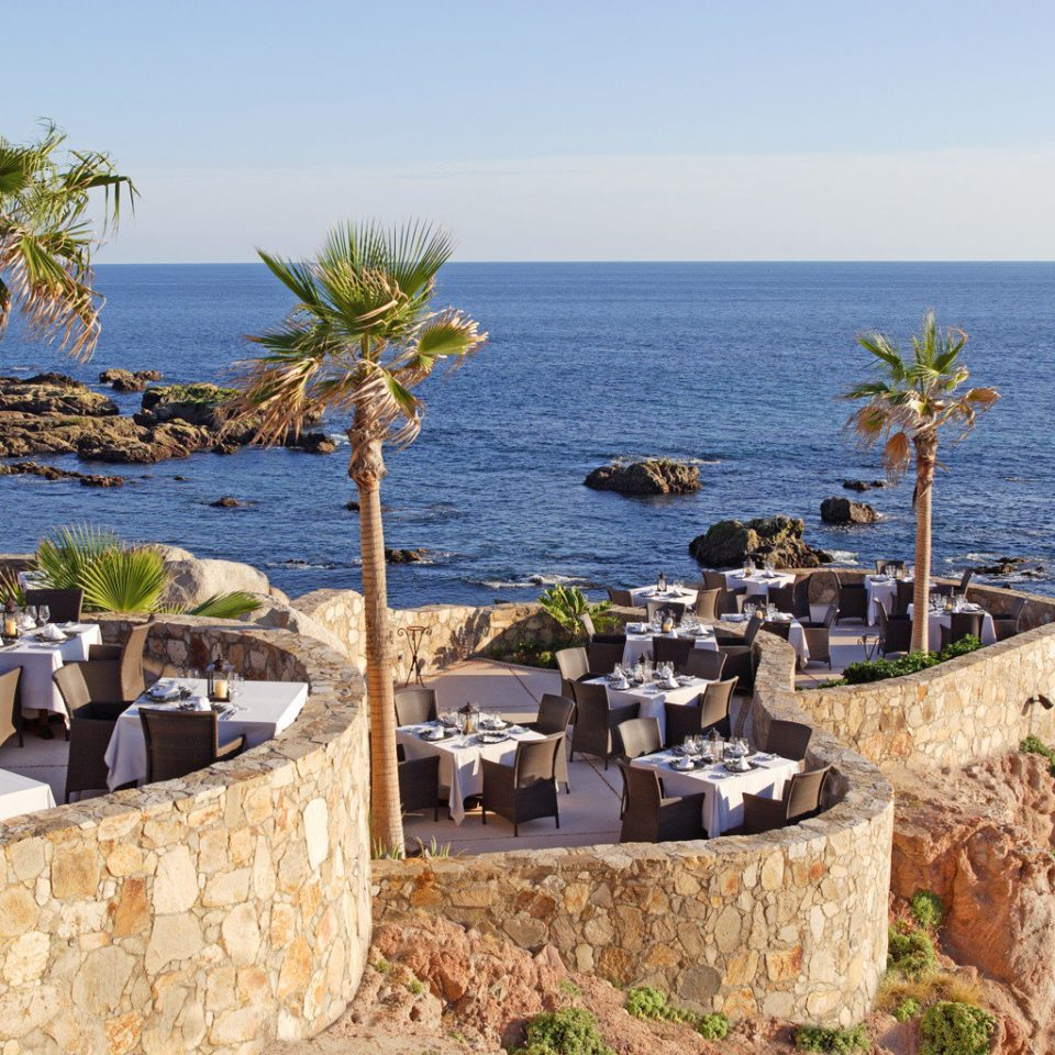 Dining Drink Eat Honeymoon Luxury Romance Romantic Scenic views Tropical Waterfront sky water Coast Sea Ocean Beach cape Resort terrain overlooking shore Island