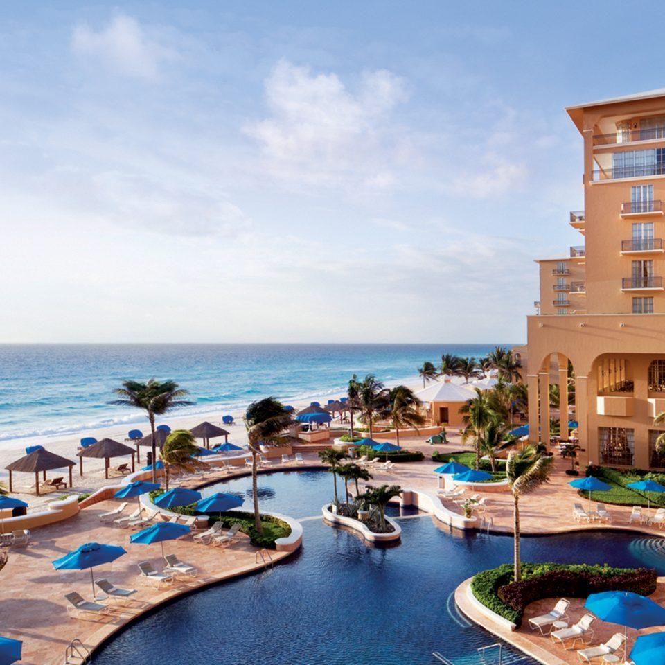 Elegant Exterior Honeymoon Luxury Pool Romance Romantic Scenic views Tropical Waterfront sky water Resort property Sea Beach Coast shore