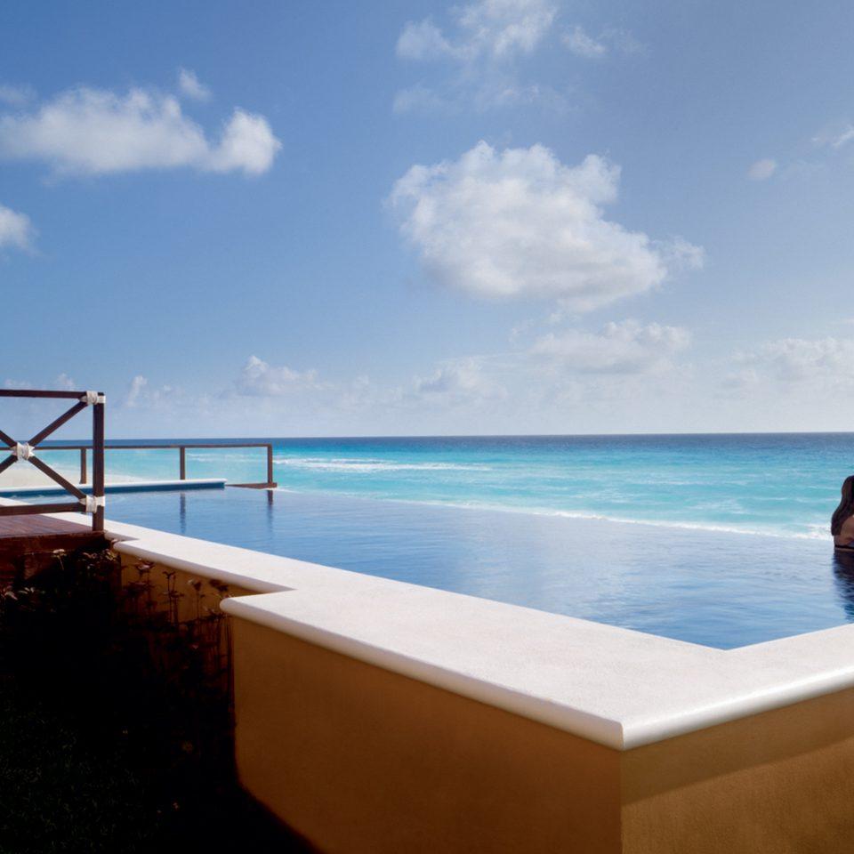 Elegant Honeymoon Luxury Pool Romance Romantic Scenic views Tropical Waterfront sky water Ocean leisure swimming pool Sea Beach Coast caribbean overlooking Resort shore