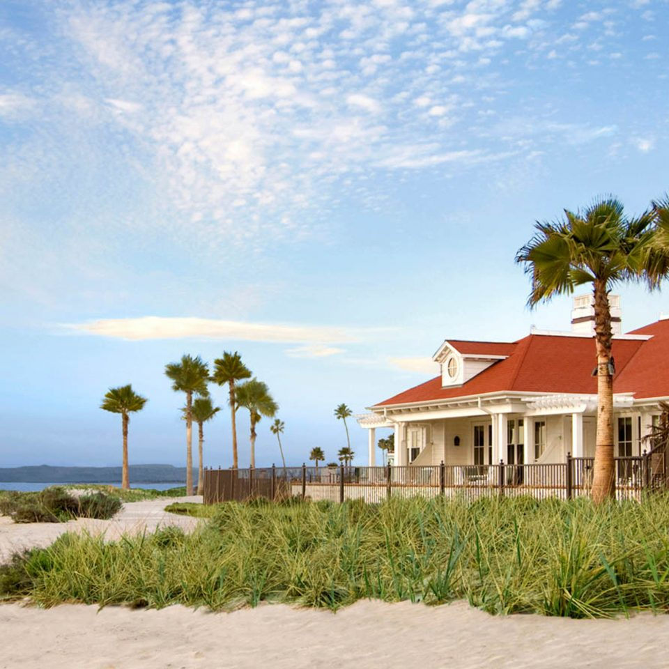 Beach Exterior Grounds Hotels Ocean Waterfront sky grass house shore Sea caribbean Coast Resort arecales landscape tropics sign