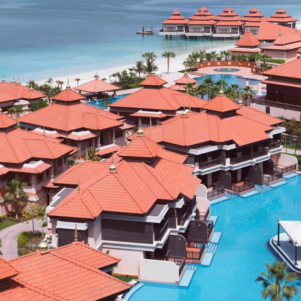 Exterior Luxury Pool Resort Waterfront building umbrella Town roof neighbourhood residential area Sea Coast Beach Village tile dock cityscape travel marina building material Island