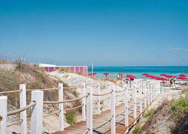 Fence sky Beach Coast property Sea walkway shore Ocean boardwalk Resort