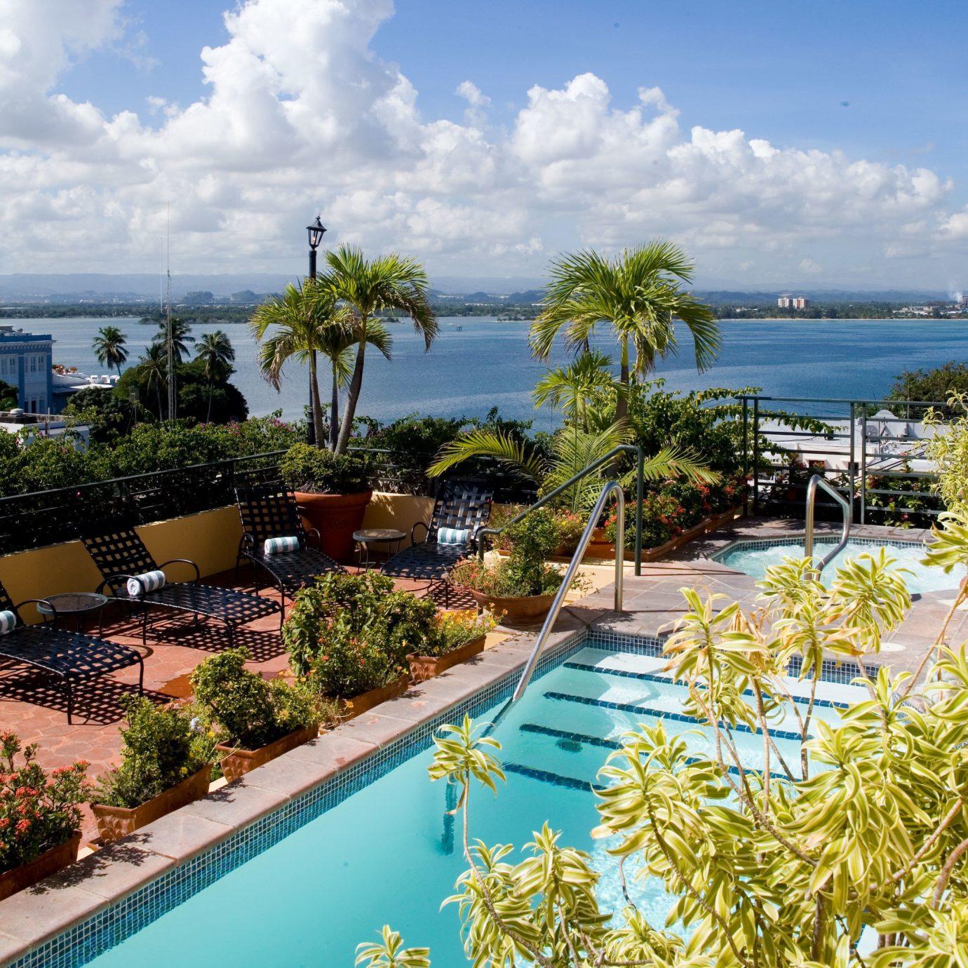 Fitness Hotels Pool Sport Wellness sky water tree swimming pool property Resort caribbean Nature Sea Ocean arecales Beach condominium Coast Lagoon Villa tropics overlooking shore
