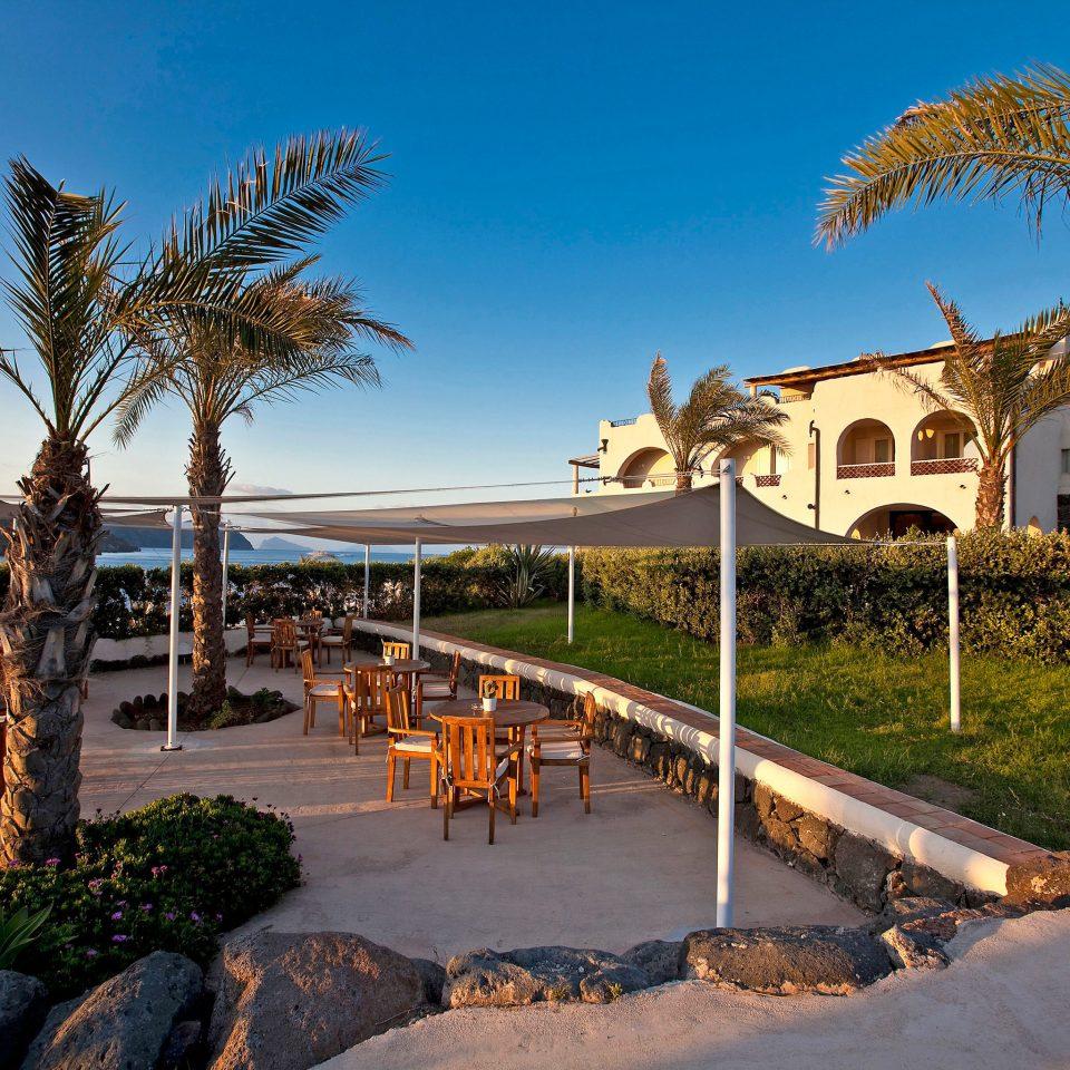 Resort Romance Wellness sky tree property palm house walkway Beach arecales home Coast Villa Sea Garden plant lined