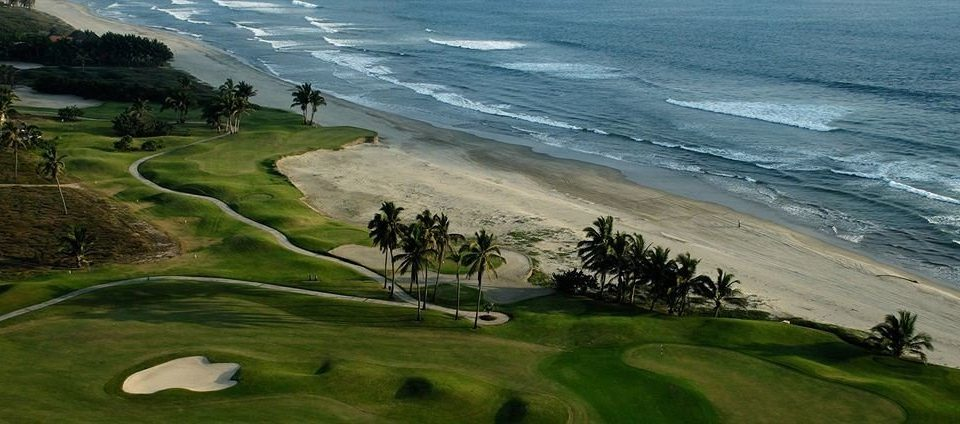 Beach Golf Honeymoon Resort Sport Waterfront grass water Nature structure sport venue sports golf course Ocean golf club aerial photography Coast terrain cape shore plant overlooking lush hillside