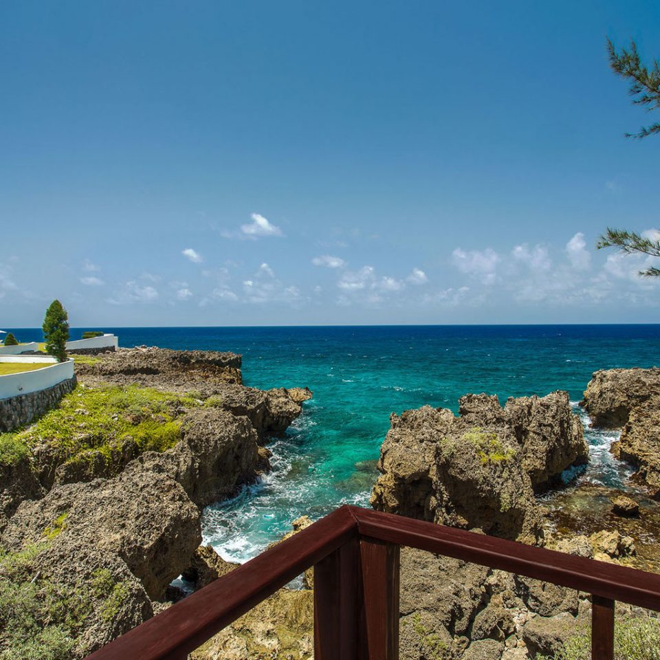 Grounds Luxury Romance Romantic Scenic views Tropical Waterfront sky Sea Coast shore Nature Ocean Beach caribbean Island cape tropics cove islet terrain Lagoon cliff overlooking